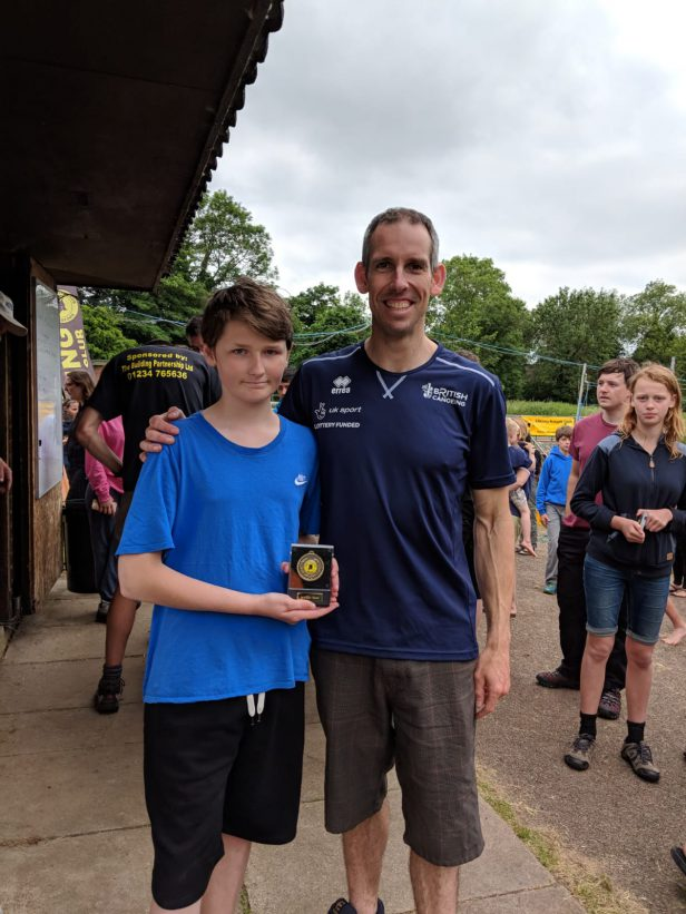 Alex receiving his medal from Olympic Champion Etienne Stott